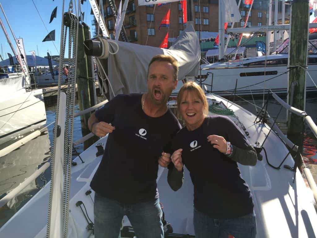 Matt and Emily with OCSC t-shirts in a J24