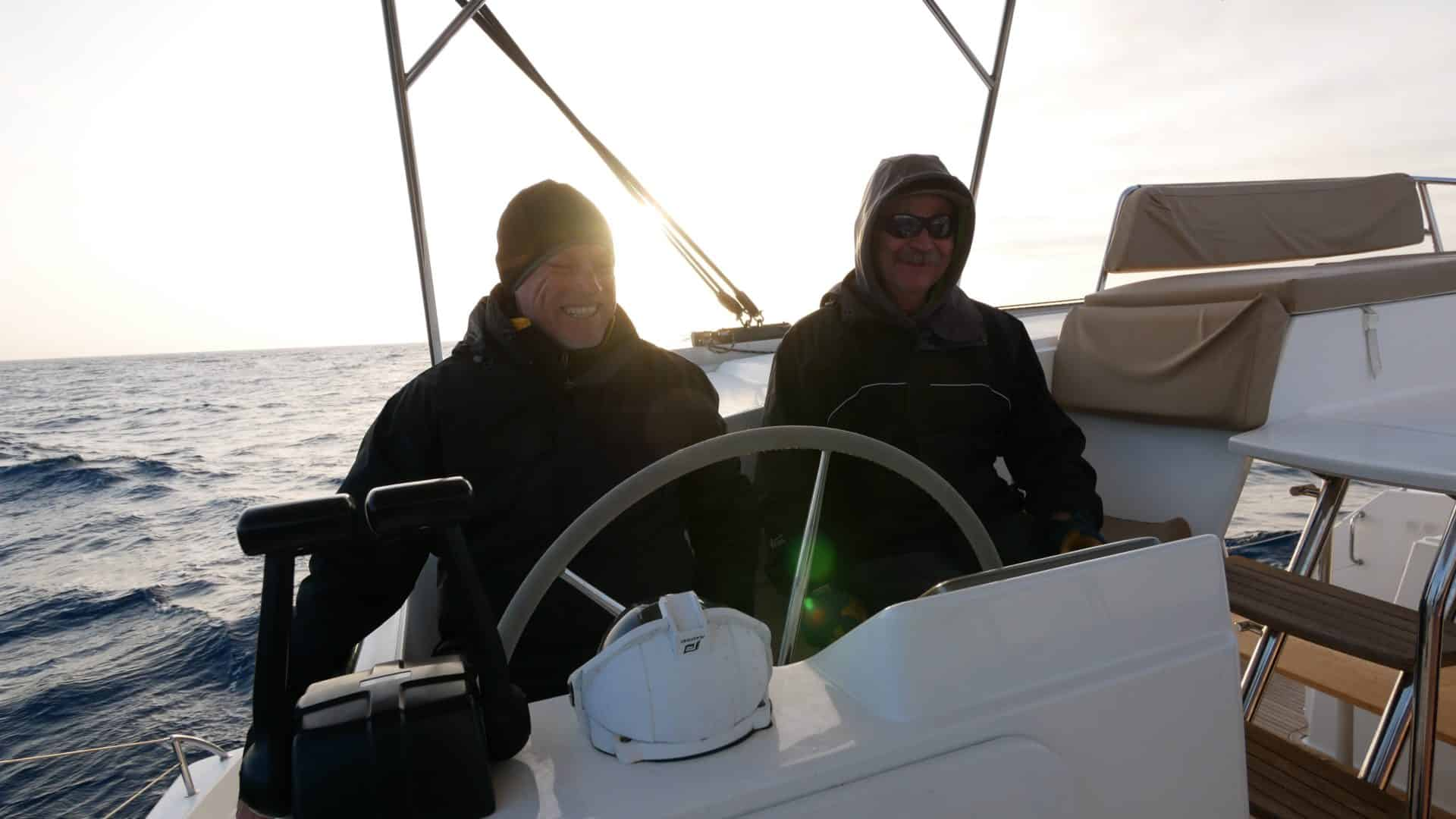 Captain Chas and Tim at the helm of a Fountaine Pajot Helia 44