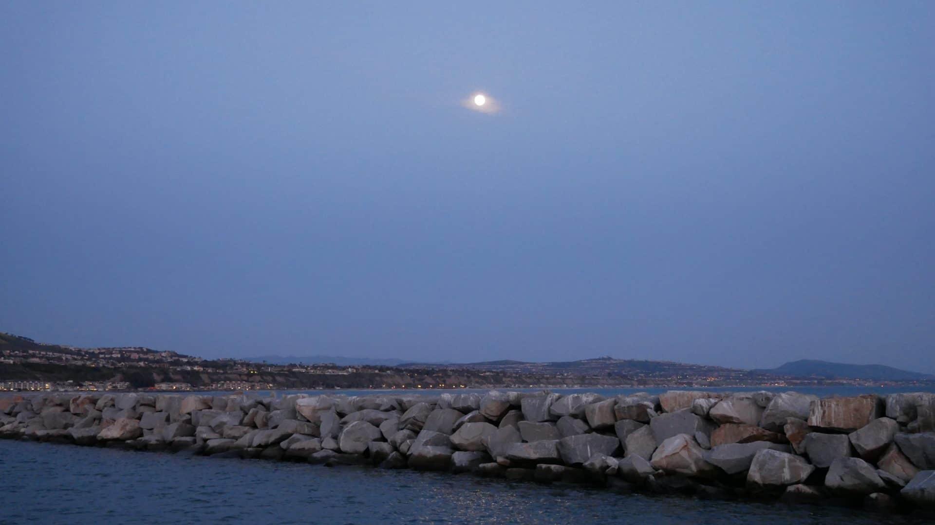 Breakwater with moon at Dana Point, California