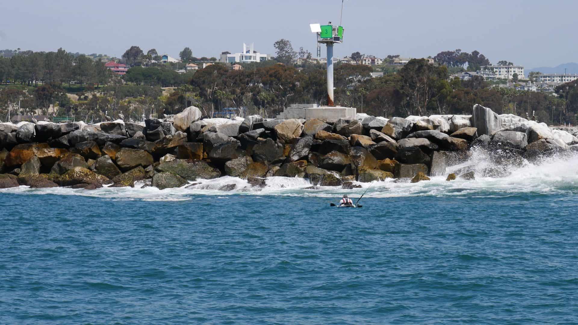 Kayaker fishing near the breakwater