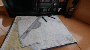 Sailing charts on the navigation station