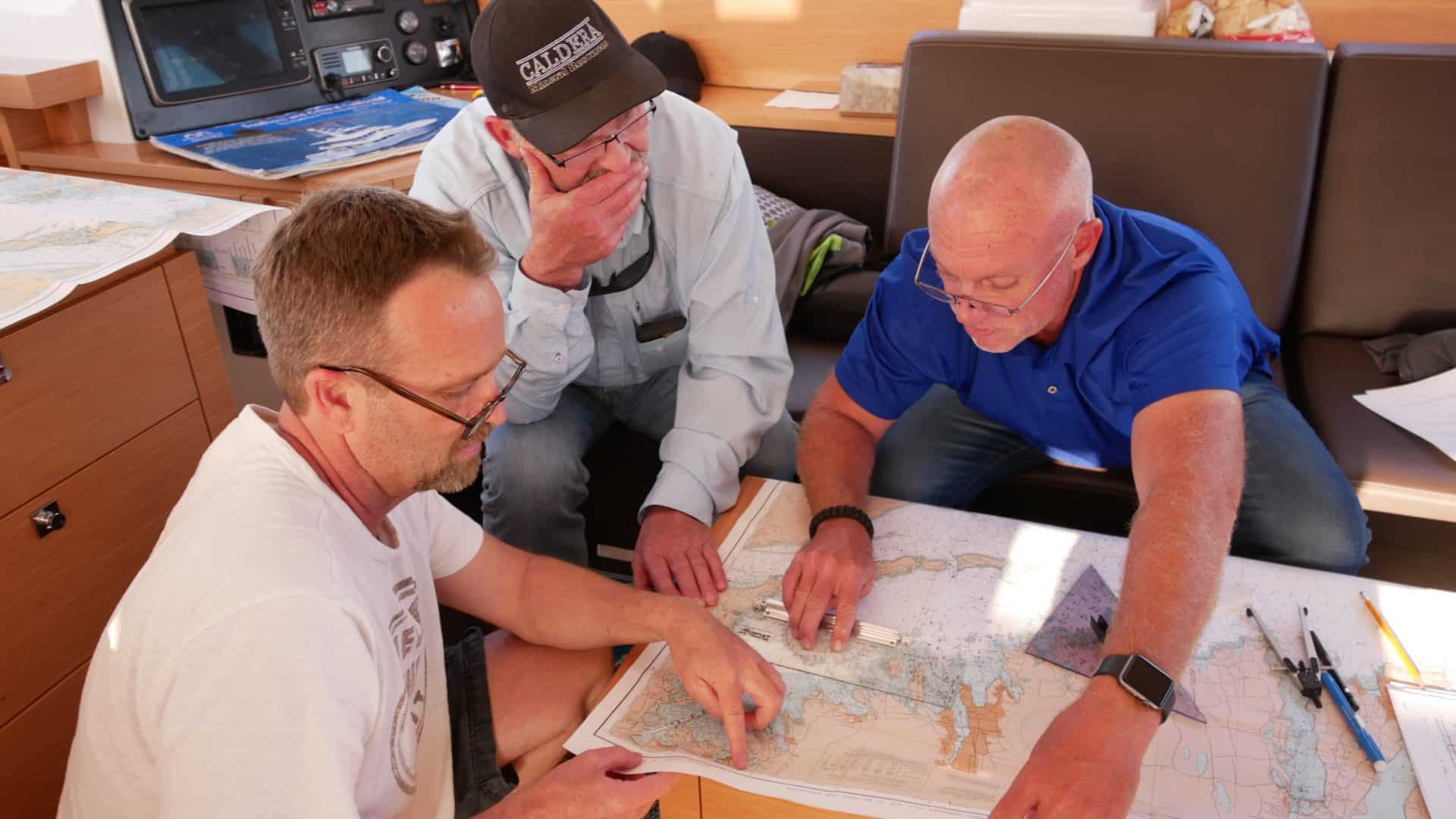 Matt, Tim Capt. Chas working on Coastal Navigation