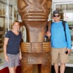 Emily and Lou standing with tall tiki