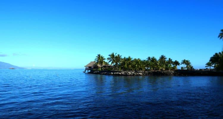 Hut at the waters edge in Tahiti