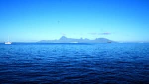 Blue sky and water with Moorea island in distance