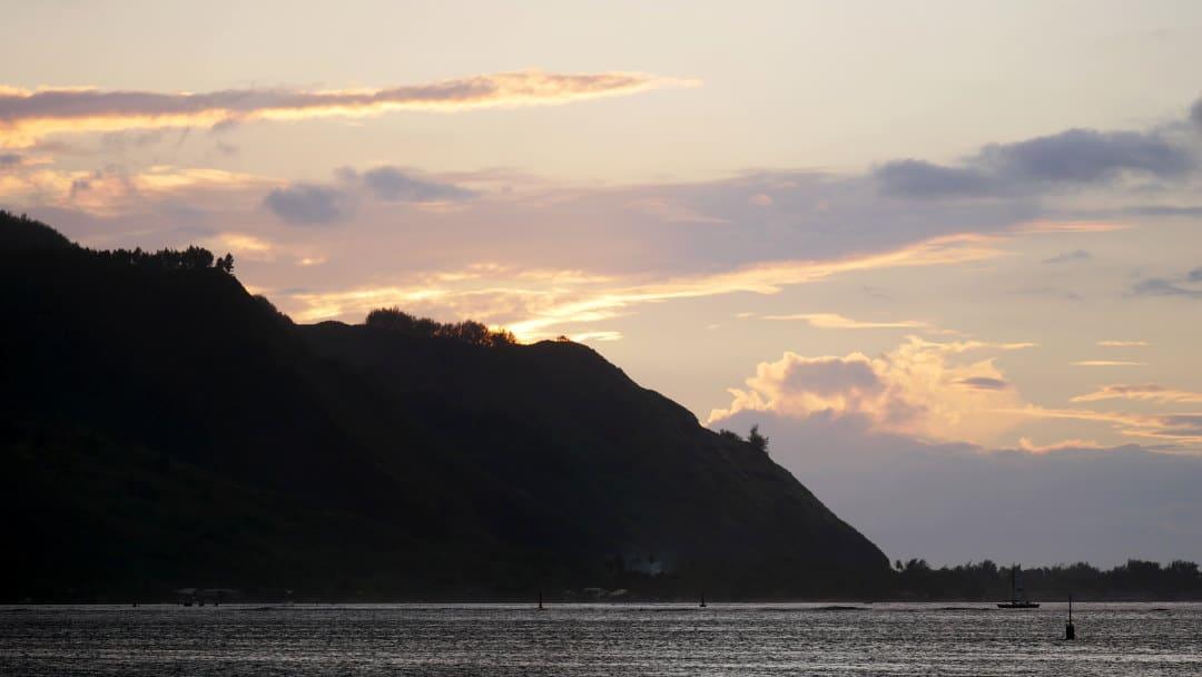 Sunset over the cliffs oceanside in Moorea