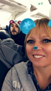 Emily doing a snapchat on the airplane