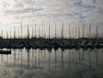 Reflection of boats in the water in La Rochelle, France