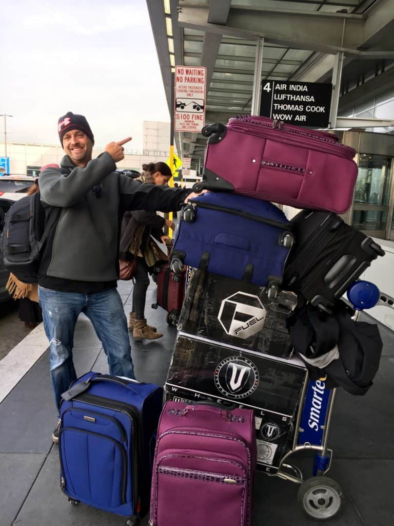 Matt pointing to our large stack of luggage