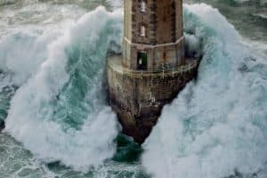 Man in lighthouse with wave