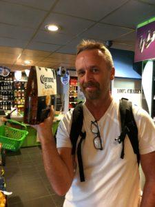 Matt holding a 3 pack of Coruna