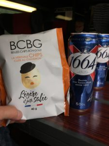 Potato chip bag and two cans of beer