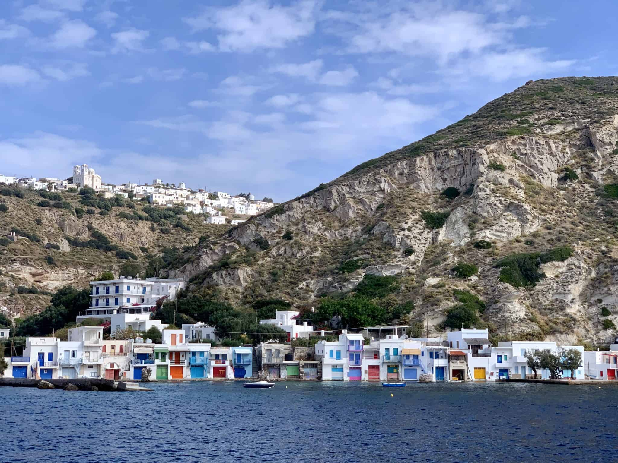 colorful boat cave houses on Milos, Greece