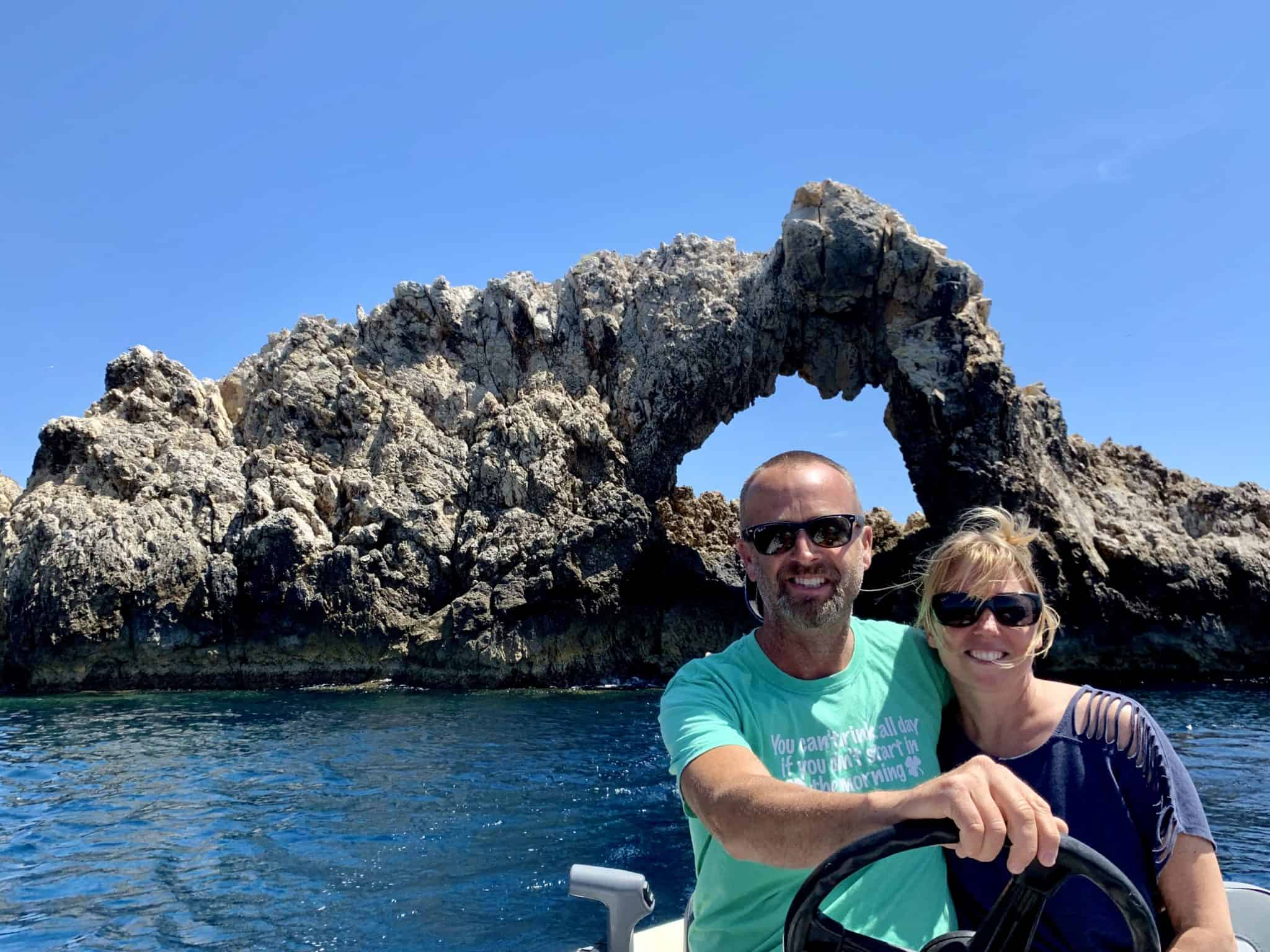 Matt & Emily in our dinghy in front of sea arch
