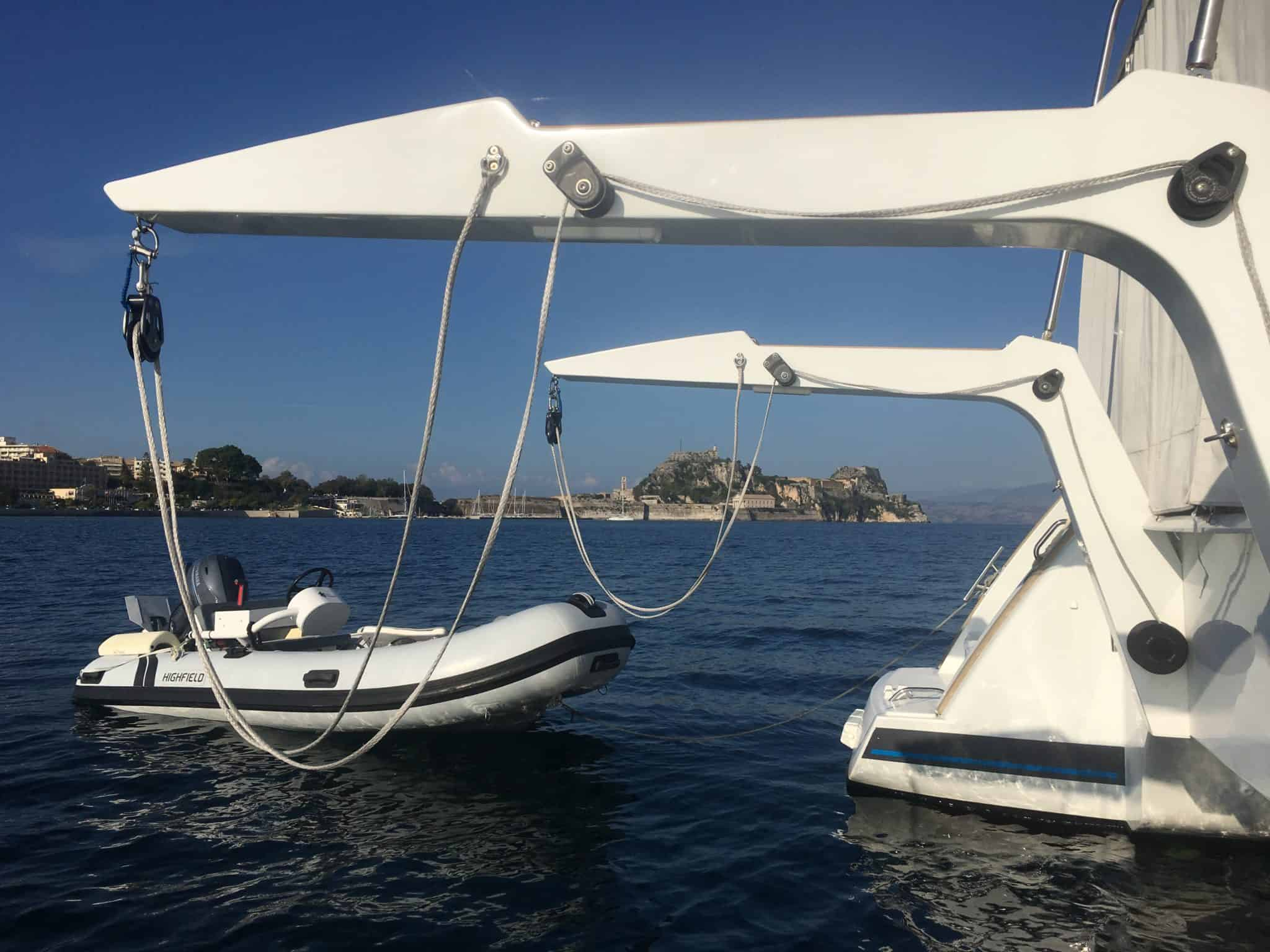 Dinghy in the water next to davits