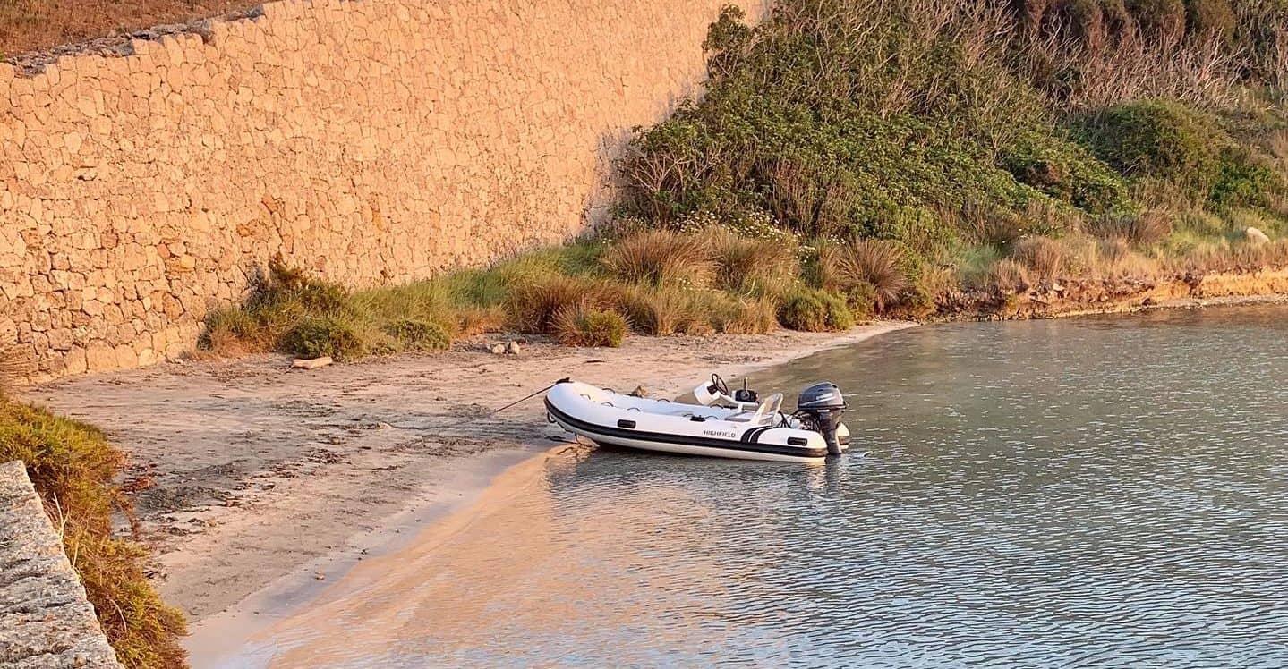 Dinghy anchored on the beach